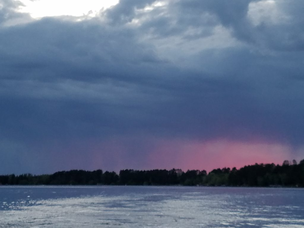 Evening sunset with a spring storm rolling in across the lake.